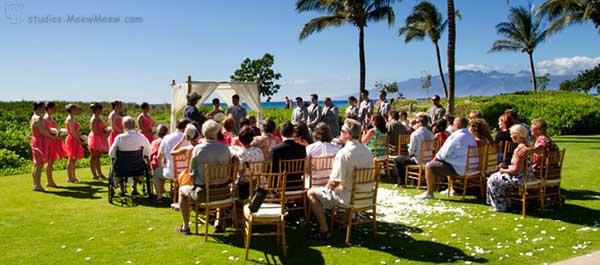 A beachfront Kaanapali wedding on the lawn at Honua Kai Resort.