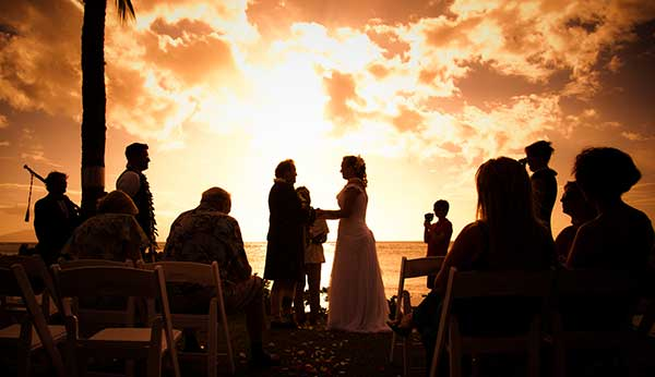 A beach wedding location in West Maui is perfect for a catered wedding reception at sunset.