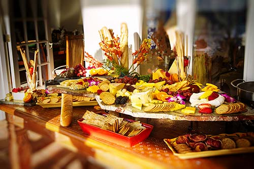 An International Cheese Display with Homemade cheeses, artisan breads and fresh fruits.