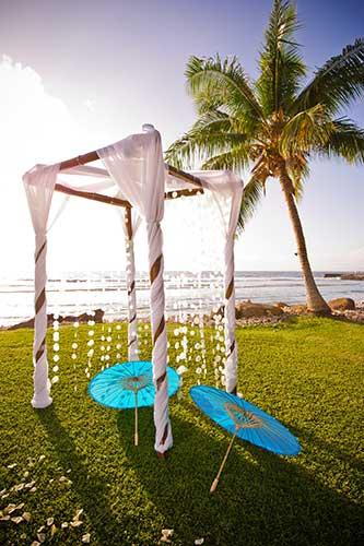 A linen draped bamboo chuppah wedding arch at Olowalu wedding in West Maui.