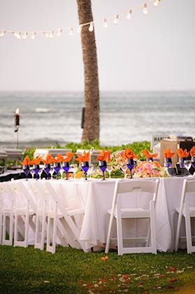 A catered wedding reception table linens and setup in West Maui.
