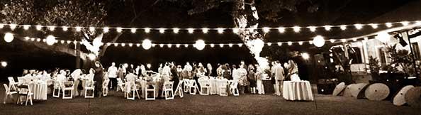 A black and white Maui wedding reception photo.