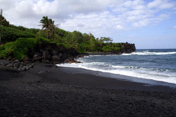 A black sand beach in Hana is an ideal spot for a picnic on Maui.