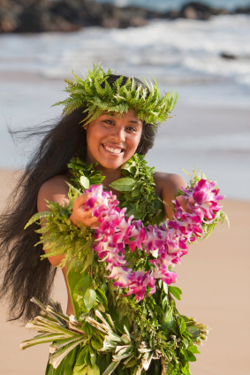 Hawaiian wedding lei - wearing a Maile Haku Lei and presenting an orchid lei to Maui wedding guests.
