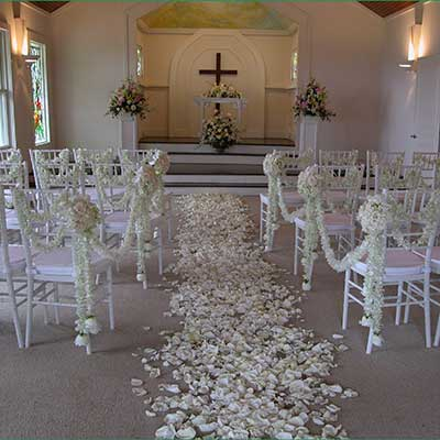The Honokowai Church in West Maui is decorated with fragrant wedding flowers for a wedding.