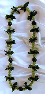 Hawaiian wedding lei kukui nut and grape leaves lei.