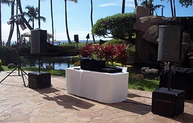Maui wedding DJ with sound equipment setup at Maui oceanfront wedding.