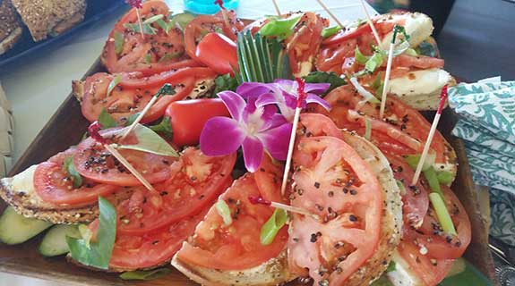 Bagels and Olowalu tomato ready for salmon and lox for a day after wedding brunch.