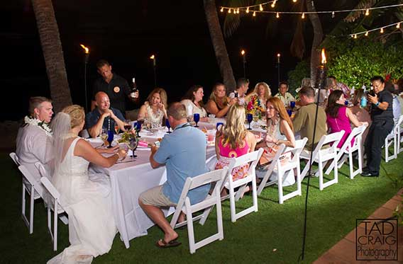 A catered beach wedding reception in Lahaina at the White House private estate.