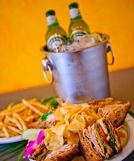 Turkey Club with fries and Heinekin at Kaanapali Restaurant.