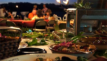 A buffet table at a wedding reception with Maui catering services.
