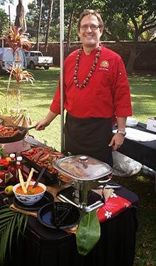 Chef Jorgensen serving guests at Maui wedding food stations.