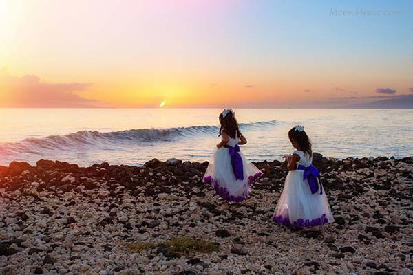 Children playing on the beach in their wedding attire at the Olowalu Plantation House in West Maui.