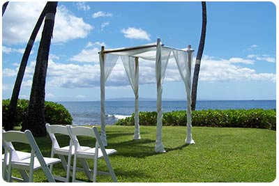 Wedding Arch in Bamboo Chuppa with the oceanfront wedding on Maui background setting image.