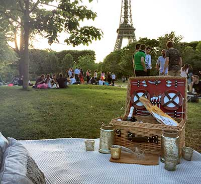 Indulge in a picnic under the Eiffel Tower from Picnics in Paris.