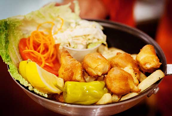 Battered fish for CJs Fish and Cips with cole slaw in Kaanapali.