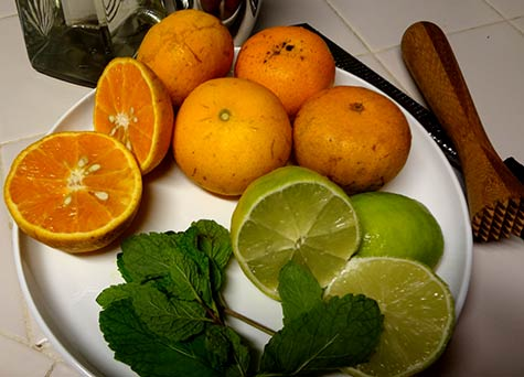 Fresh organic tropical tangerines, lemon and mint for Maui cocktails.