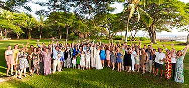 A large wedding with family photo in West Maui.