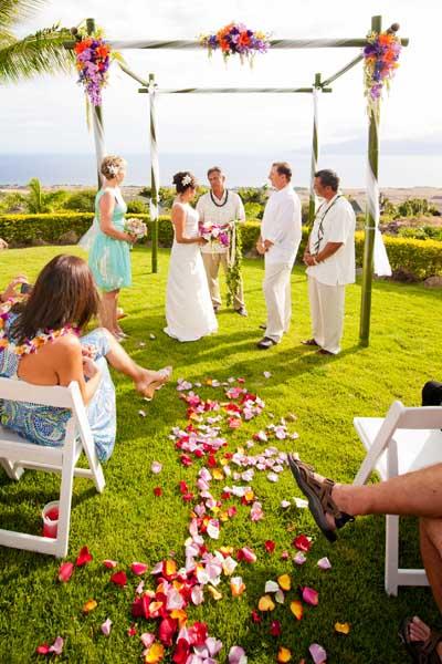 Maui wedding location with bamboo wedding chuppa at the Maui Majestic private wedding estate.
