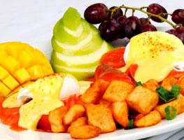 Eggs Benedict at Maui restaurant with classic Hollandaise sauce.