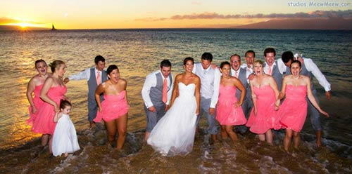 A wedding party gathered for sunset photos at the Kaanapali beach wedding.