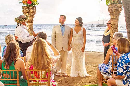 A Maui beach wedding location in Lahaina with sailboats in the background.