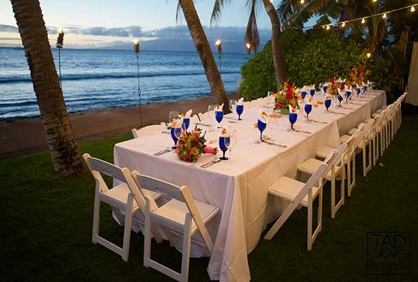 Dinner table setting for a catered wedding in Lahaina at the White House on Front Street.