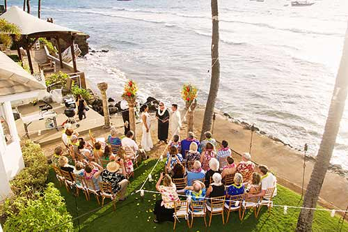A Lahaina beachfront wedding ceremony at the White House private estate in West Maui.