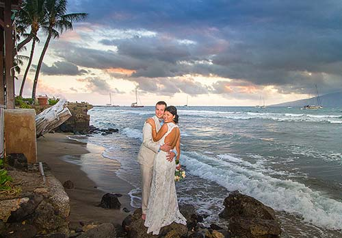 A happy newlywed couple captured by a professional Maui wedding photographer in Lahaina.