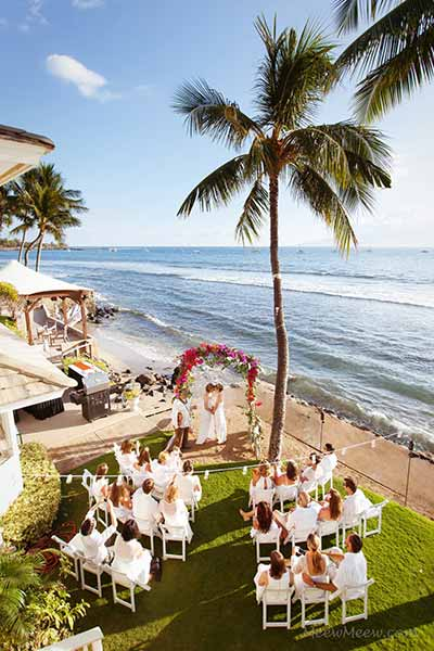 A beachfront wedding on Maui at white house private estate in Lahaina.