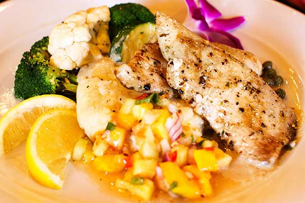 Nothing like fresh Mahi Mahi served with a lite lemon caper sauce and a side of pineapple salsa and steamed vegetables for an affordable dinner in Kaanapli.
