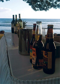 A beer and wine bar service for a sunset beach wedding in West Maui at the Olowalu Plantation house estate wedding venue..