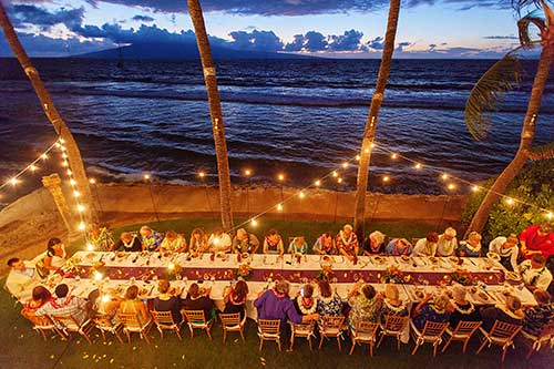 A Lahaina beach front wedding reception dinner catered by CJs Maui in Kaanapali.