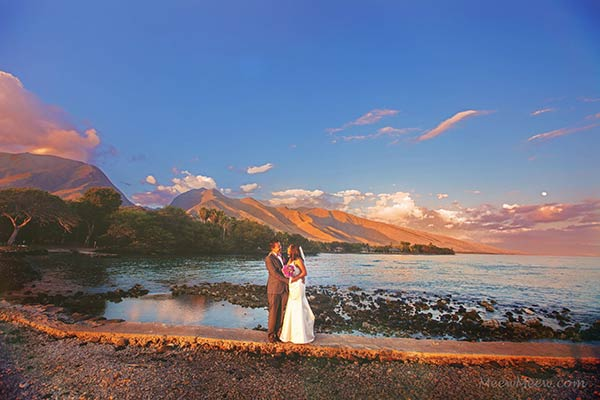 A sunset Maui wedding photograph of the just married couple at Olowalu Plantation House.