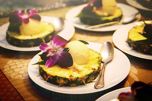 Passion Fruit Sorbet in a Pineapple boat for a catered wedding reception dinner in Maui.