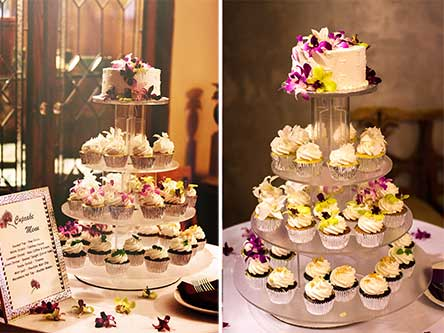An image of a Maui wedding cupcake tree topped with a small wedding cake.