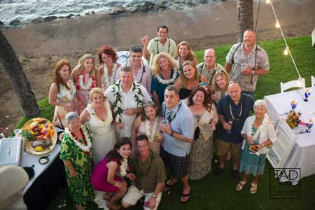 A catered wedding reception on Maui in Lahaina at the White House Private Estate oceanfront vacation rental.