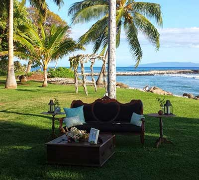 A catered Maui wedding with a vintage theme at the Olowalu Plantation house private estate wedding venue.