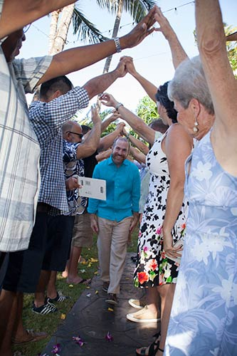 A Maui wedding arch formed by friends and family of the gay couple just before getting married in Kihei.