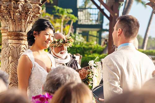 The couple exchange vows at their wedding in Lahaina.