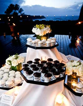 Maui wedding cupcakes in front of oceanfront wedding venue on Maui northcoast.