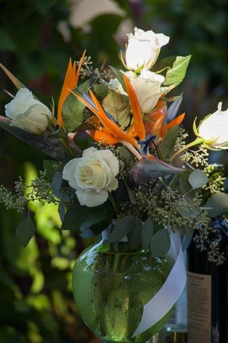 A vase of fresh cut Maui wedding flowers