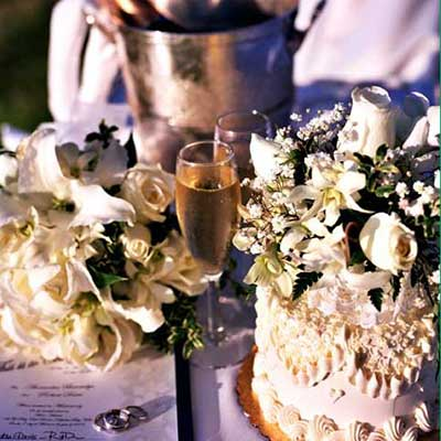 Maui wedding cakes with champagne at catered wedding.