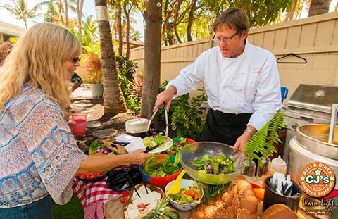The chef serves a private dinner for a barbecue on Maui.