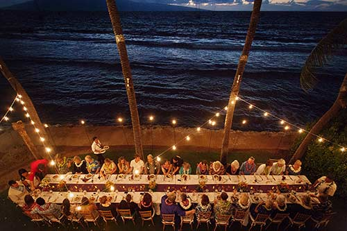 An oceanfront dinner in Lahaina for a wedding reception.