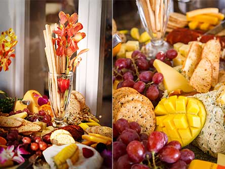 Fresh tropical flowers and fruits are included with catered cheese platters on Maui.
