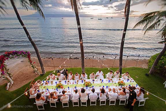An oceanfront wedding reception at the White House private estate in Lahaina with lime green runners and cobalt blue glasses.