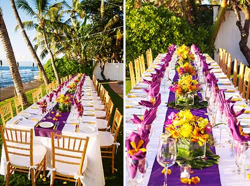 A beach wedding reception dinner table settings with purple table runners, bamboo chairs.and bamboo utensils. Service for 40 guests.