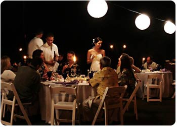 A catered Maui wedding reception with wedding lights.