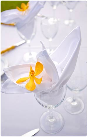 Wedding table decorations with orchid flowers at Olowalu in West Maui.